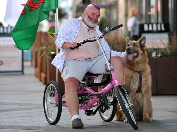 How a Bright Pink trike can help 'a Guy' with MS to walk his dog again